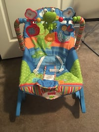 toddler's blue and green Fisher-Price bouncer seat