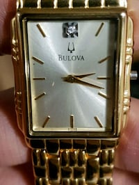 square silver analog watch with gold link bracelet Winnipeg, R2L 0L5
