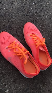 pair of pink Nike running shoes Gainesville, 20155