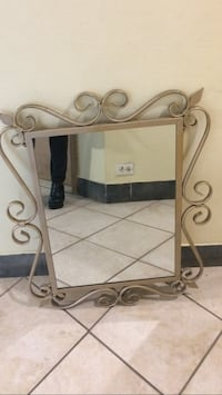 Metal frame mirror can be used both ways