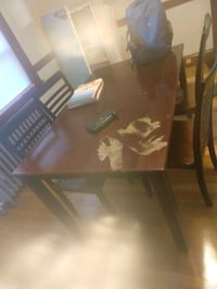 Brown and black wooden dining set