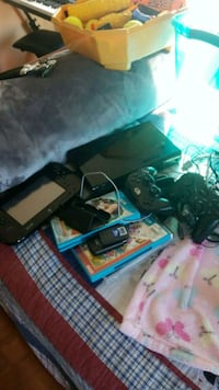 black Sony PS3 slim console with controller and game cases Manassas Park, 20111