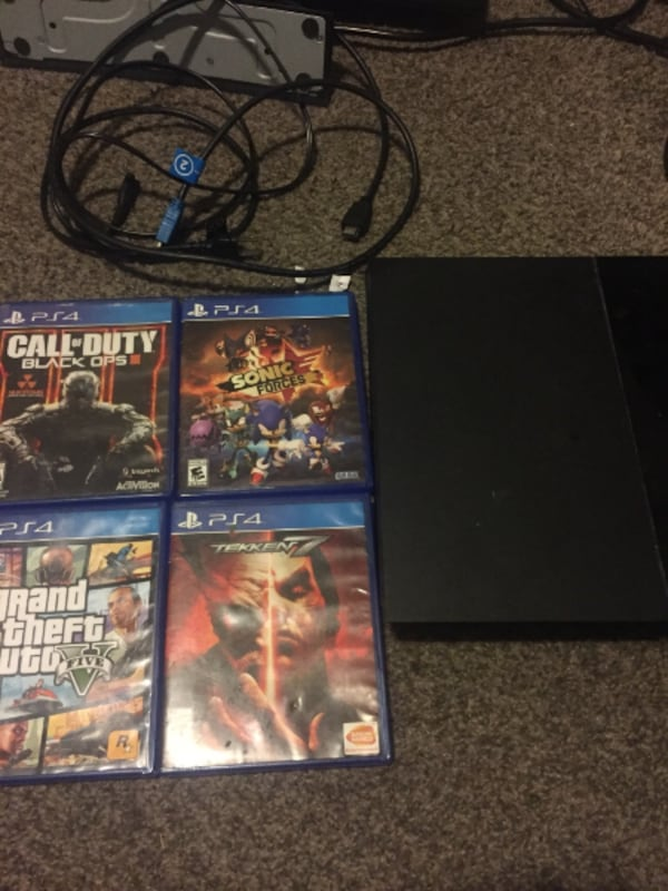 PS4 with all cords and 8 games but no controller  a7e01d71-ca01-49a9-bd4a-9204dbc7dc85