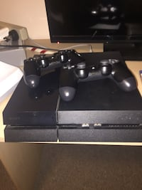 Black sony ps4 console with controllers Kelowna, V1X 1Y9