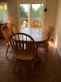 oval brown wooden table with four windsor chairs dining set Guelph, N1E 6S9