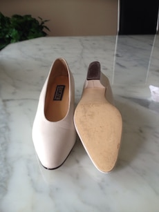 Women's pair of cream leather shoes.
