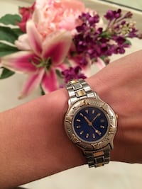 Round Limited silver with blue face analog watch