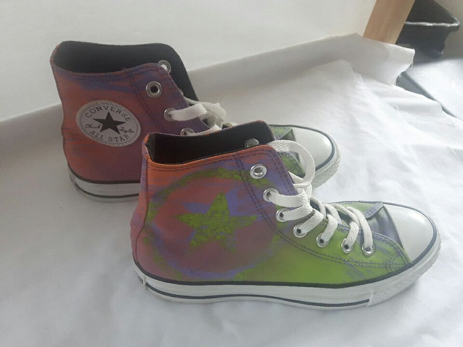 green-and-purple Converse Chuck Taylor high's