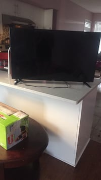 black flat screen TV with remote Calgary, T3K