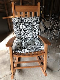 brown wooden framed white and black floral padded armchair