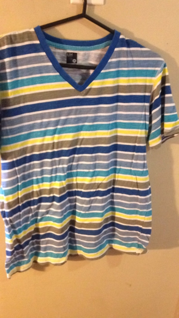 blue, white, and yellow striped polo shirt