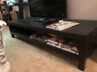 Short black entertainment center. near brand new just wrong size for our living room. Phoenix, 85027