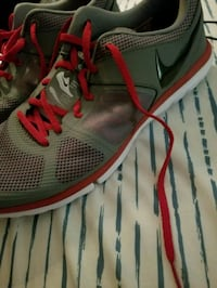 pair of gray-and-red Nike running shoes Trophy Club, 76262