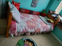 Small bed apart of bunk bed with mattress