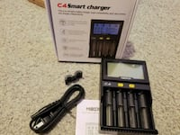 black C4 smart charger with USB cable and box Toronto, M6G