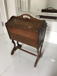 brown wooden 2-drawer end table 581 km