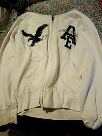 white and black zip-up jacket Brownsville