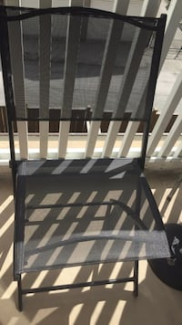 Black patio chair  Burnaby