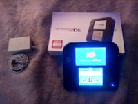 blue Nintendo DS with game cartridge 3161 km