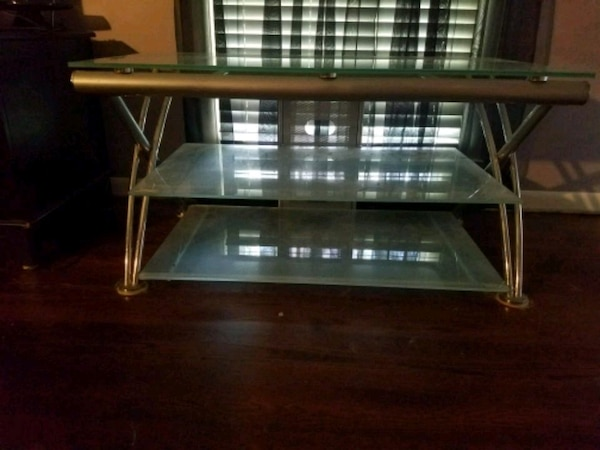 rectangular clear glass top table with brown wooden base