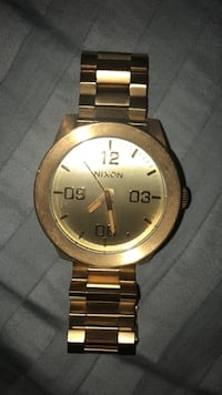round gold-colored Nixon analog watch with link bracelet East Meadow, 11554