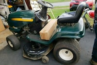 green and black Craftsman ride on mower 39 km