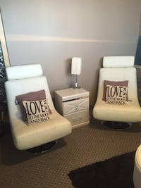 white leather hydraulic chairs with white wooden nightstand