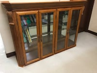 brown wooden framed glass display cabinet Côte-Saint-Luc, H4W 2W6