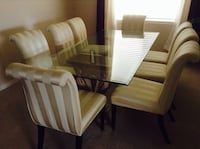 Clear glass top table with 8 chairs