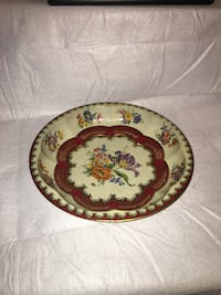 round white and red floral ceramic plate Frederick