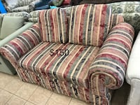 Brown and red fabric sofa