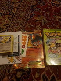Pokemon card  and book  and one big Ex charizard