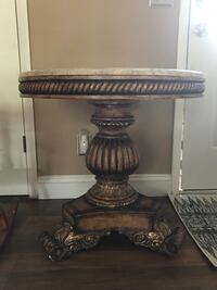 """Pedestal side table-wood with marble top (brown, gold, and cream-color marble)  27.5"""" around 28"""" tall DeBary, 32713"""