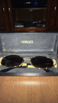 gold framed Versace sunglasses with case