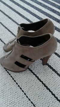 pair of gray suede ankle strap heeled shoes