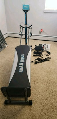 black and white Total Gym XLS exercise equipment Golden, 80401