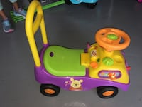toddler's pink and green ride on toy Cedar Park