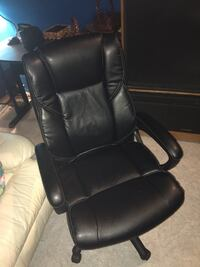 Black leather padded rolling armchair 9 km