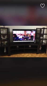 black wooden TV stand with flat screen television Toronto, M9L 2C5