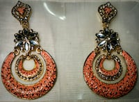 two silver and red gemstone embellished earrings Baltimore, 21207