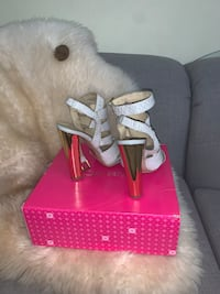 Strappy heeled sandals.Size 9 worn price is negotiable. Toronto, M6C 2M1