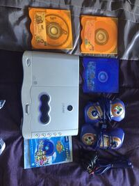 Gray vtech v flash console with blue game controllers Edmonton, T5W 4V6