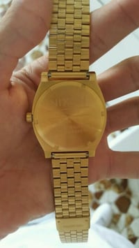round gold-colored analog watch with link bracelet 2273 mi