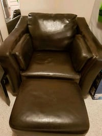brown leather padded sofa chair Beaumont, T4X 1V1