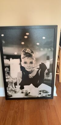 Audrey Hepburn grayscale photo with black wooden frame 74 km