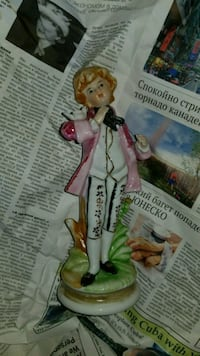 boy with pink suit jacket figurine