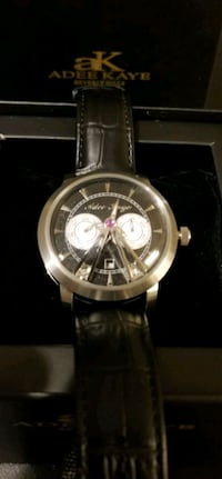 round silver chronograph watch with black leather  Middletown, 02842
