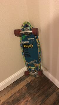 blue and green Royalty skateboard