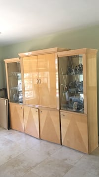 brown wooden cabinet with display cabinets