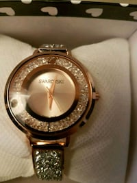 round gold Swarovski analog watch with gold lin Richmond, V6Y 2Y5
